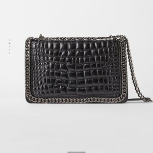 Cross body bag with embossed leather
